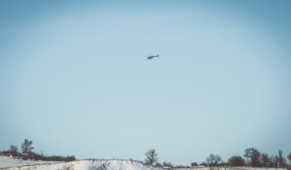 one of the helicopters that was constantly circling above camp